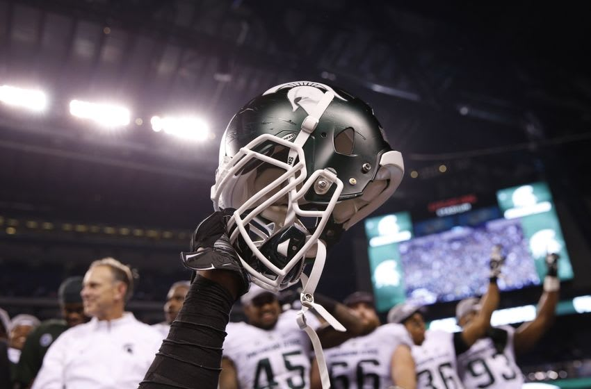 Dec 5, 2015; Indianapolis, IN, USA; A helmet is raised in celebration after the Michigan State Spartans defeated the Iowa Hawkeyes in the Big Ten Conference football championship game at Lucas Oil Stadium. Mandatory Credit: Brian Spurlock-USA TODAY Sports