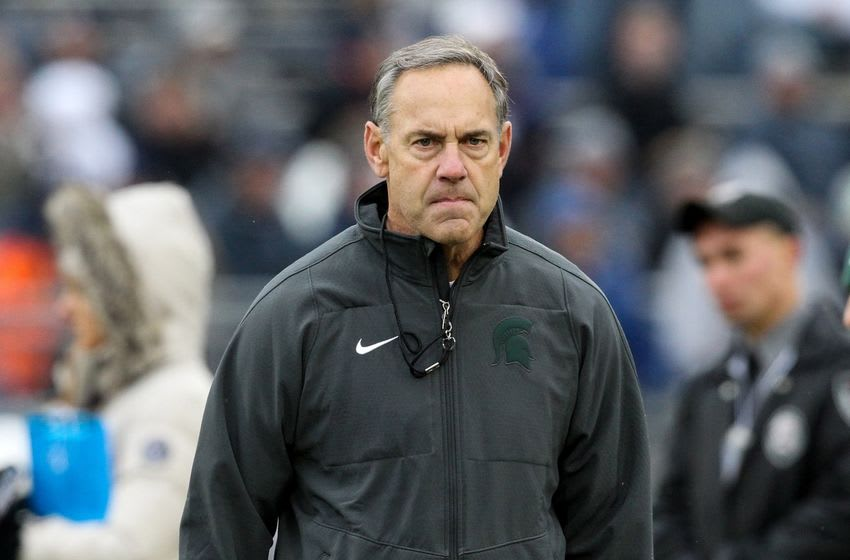 Nov 26, 2016; University Park, PA, USA; Michigan State Spartans Mark Dantonio walks on the field during a warmup prior to the game against the Penn State Nittany Lions at Beaver Stadium. Mandatory Credit: Matthew O