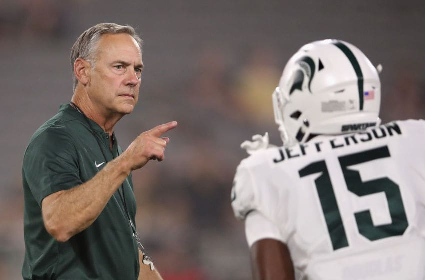 TEMPE, AZ - SEPTEMBER 08: Head coach Mark Dantonio of the Michigan State Spartans reacts during warm ups to the college football game against the Arizona State Sun Devils at Sun Devil Stadium on September 8, 2018 in Tempe, Arizona. (Photo by Christian Petersen/Getty Images)