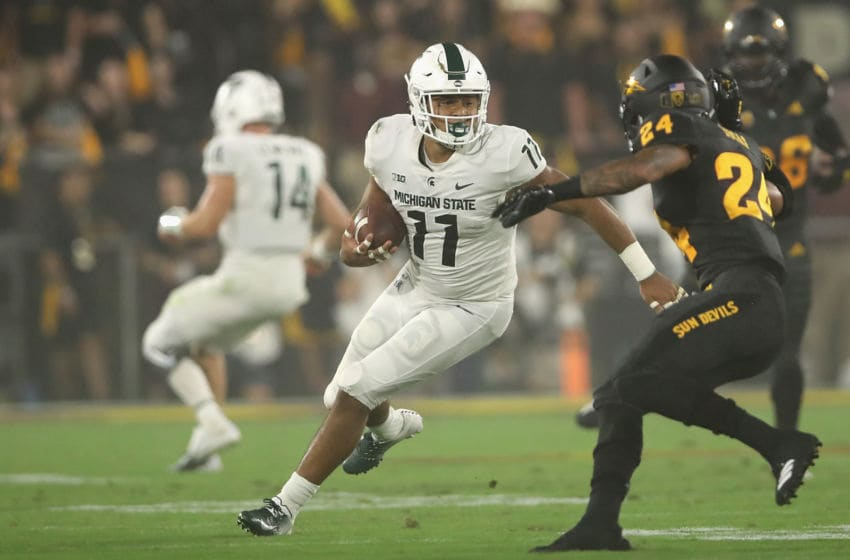 TEMPE, AZ - SEPTEMBER 08: Running back Connor Heyward #11 of the Michigan State Spartans rushes the football against the Arizona State Sun Devils during the first half of the college football game at Sun Devil Stadium on September 8, 2018 in Tempe, Arizona. (Photo by Christian Petersen/Getty Images)
