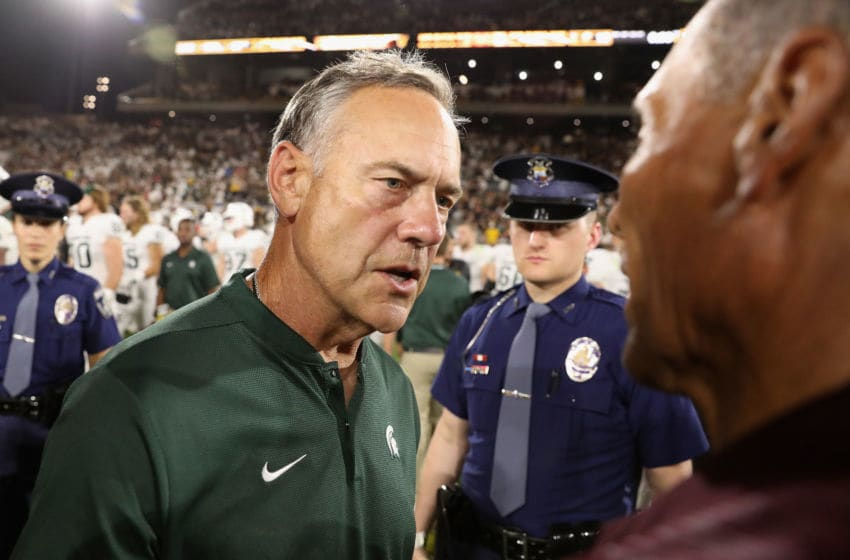 TEMPE, AZ - SEPTEMBER 08: Head coach Mark Dantonio (L) of the Michigan State Spartans greets head coach Herm Edwards of the Arizona State Sun Devils following the college football game at Sun Devil Stadium on September 8, 2018 in Tempe, Arizona. The Sun Devils defeated the Spartans 16-13. (Photo by Christian Petersen/Getty Images)