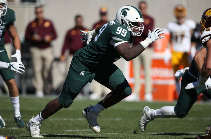 EAST LANSING, MI - SEPTEMBER 29: Raequan Williams #99 of the Michigan State Spartans rushes the quarterback while playing the Central Michigan Chippewas at Spartan Stadium on September 29, 2018 in East Lansing, Michigan. Michigan State won the game 31-20. (Photo by Gregory Shamus/Getty Images)