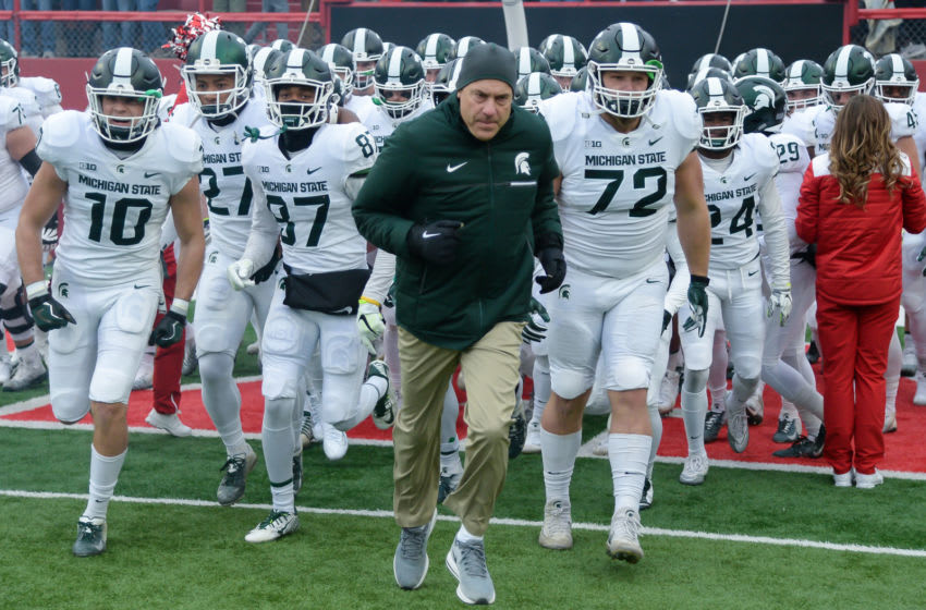 LINCOLN, NE - NOVEMBER 17: Head coach Mark Dantonio of the Michigan State Spartans leads the team on the field before the game against the Nebraska Cornhuskers at Memorial Stadium on November 17, 2018 in Lincoln, Nebraska. (Photo by Steven Branscombe/Getty Images)