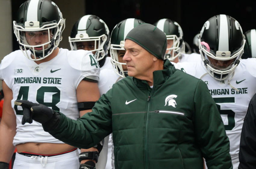 LINCOLN, NE - NOVEMBER 17: Head coach Mark Dantonio of the Michigan State Spartans walks on the field with the team before the game against the Nebraska Cornhuskers at Memorial Stadium on November 17, 2018 in Lincoln, Nebraska. (Photo by Steven Branscombe/Getty Images)