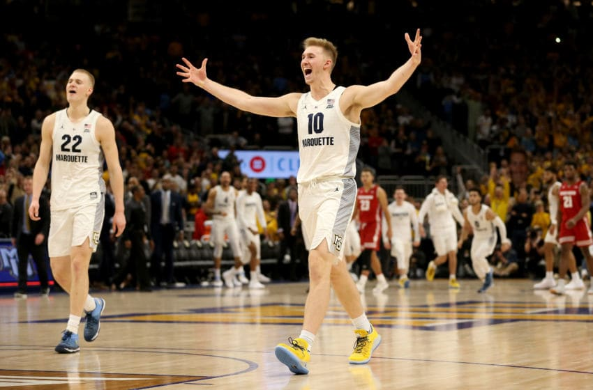 MILWAUKEE, WISCONSIN - DECEMBER 08: Joey Hauser #22 and Sam Hauser #10 of the Marquette Golden Eagles celebrate after beating the Wisconsin Badgers 74-69 in overtime at the Fiserv Forum on December 08, 2018 in Milwaukee, Wisconsin. (Photo by Dylan Buell/Getty Images)