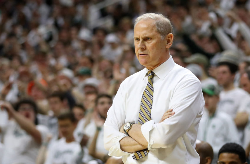 EAST LANSING, MI - MARCH 09: Head coach John Beilein of the Michigan Wolverines looks on during the first half against the Michigan State Spartans at Breslin Center on March 9, 2019 in East Lansing, Michigan. (Photo by Gregory Shamus/Getty Images)
