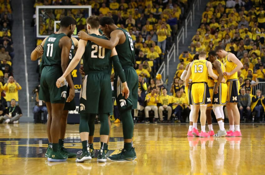 ANN ARBOR, MICHIGAN - FEBRUARY 24: Matt McQuaid #20 of the Michigan State Spartans and his teammates prepare to play the Michigan Wolverines at Crisler Arena on February 24, 2019 in Ann Arbor, Michigan. (Photo by Gregory Shamus/Getty Images)