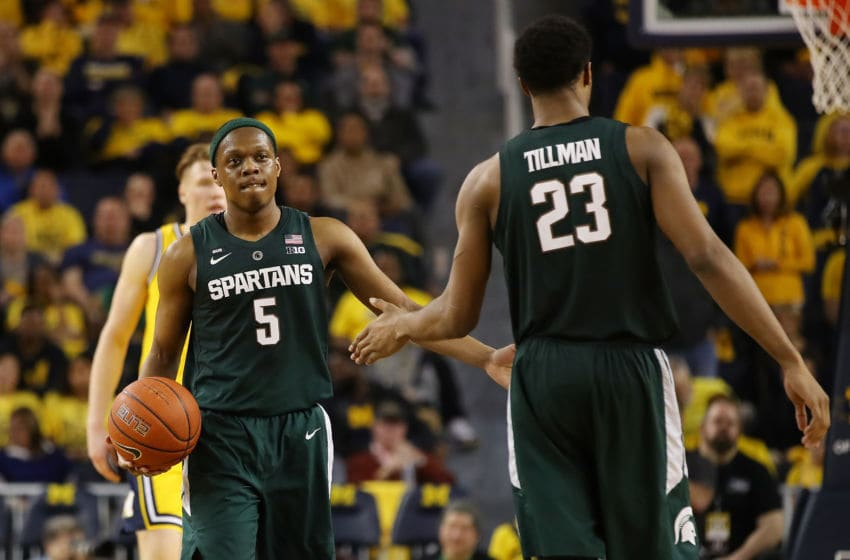 ANN ARBOR, MICHIGAN - FEBRUARY 24: Cassius Winston #5 of the Michigan State Spartans celebrates a second half play with Xavier Tillman #23 while playing the Michigan Wolverines at Crisler Arena on February 24, 2019 in Ann Arbor, Michigan. Michigan State won the game 77-70. (Photo by Gregory Shamus/Getty Images)