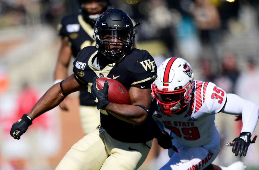 WINSTON SALEM, NORTH CAROLINA - NOVEMBER 02: Kenneth Walker III #25 of the Wake Forest Demon Deacons runs with the ball in the second quarter during their game against the North Carolina State Wolfpack at BB&T Field on November 02, 2019 in Winston Salem, North Carolina. (Photo by Jacob Kupferman/Getty Images)