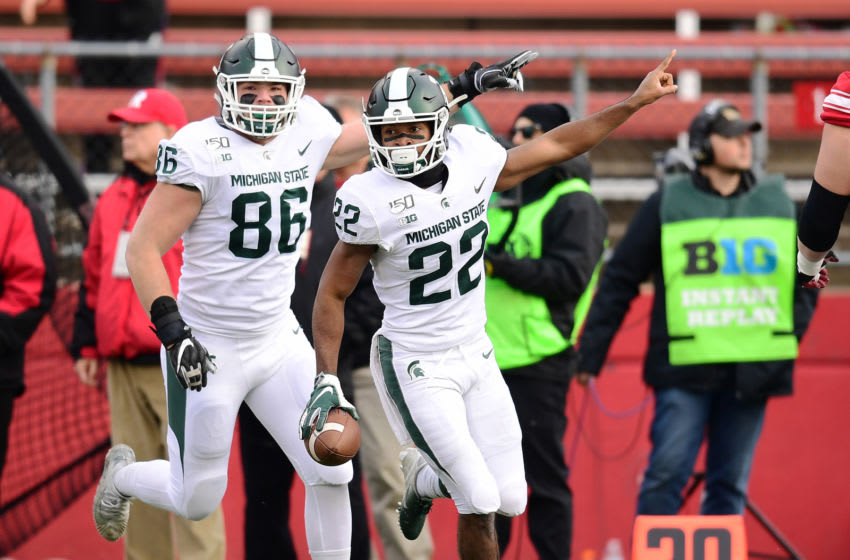 PISCATAWAY, NEW JERSEY - NOVEMBER 23: Drew Beesley #86 and Josiah Scott #22 of the Michigan State Spartans react during the second half of their game against the Rutgers Scarlet Knights at SHI Stadium on November 23, 2019 in Piscataway, New Jersey. (Photo by Emilee Chinn/Getty Images)