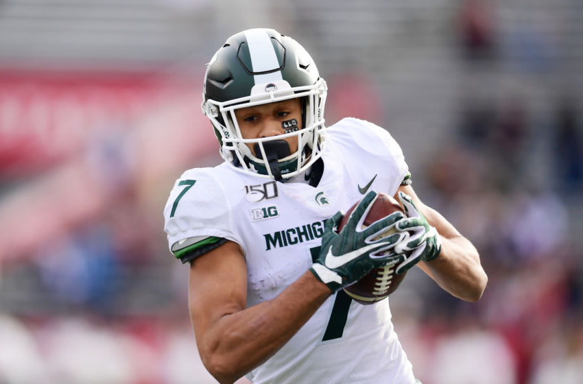 PISCATAWAY, NEW JERSEY - NOVEMBER 23: Cody White #7 of the Michigan State Spartans runs the ball in the second half of their game against the Rutgers Scarlet Knights at SHI Stadium on November 23, 2019 in Piscataway, New Jersey. (Photo by Emilee Chinn/Getty Images)