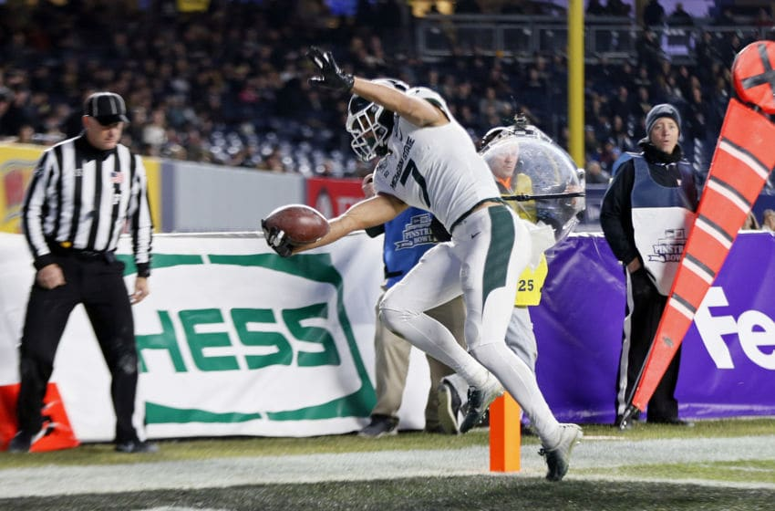NEW YORK, NY - DECEMBER 27: Wide receiver Cody White #7 of the Michigan State Spartans scores a touchdown against the Wake Forest Demon Deacons during the second half of the New Era Pinstripe Bowl at Yankee Stadium on December 27, 2019 in the Bronx borough of New York City. Michigan State Spartans won 27-21. (Photo by Adam Hunger/Getty Images)