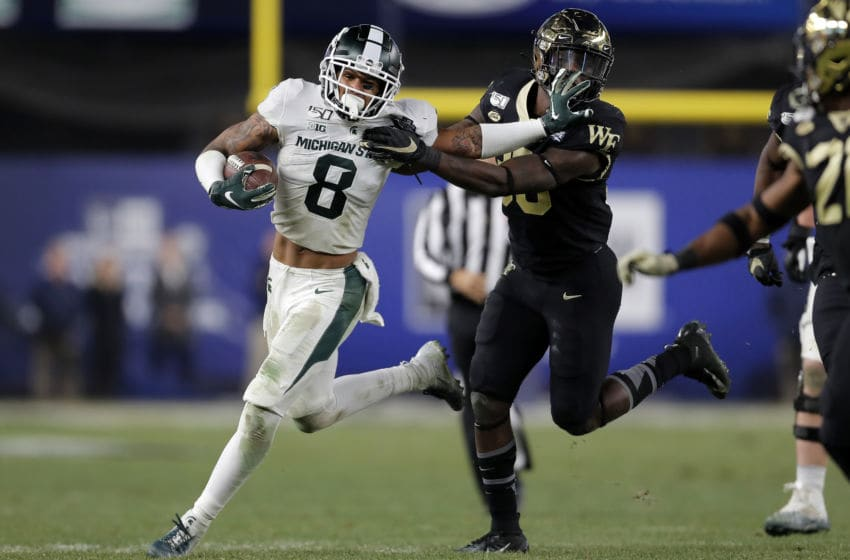 NEW YORK, NY - DECEMBER 27: Wide receiver Jalen Nailor #8 of the Michigan State Spartans rushes past linebacker Ja'Cquez Williams #30 of the Wake Forest Demon Deacons during the second half of the New Era Pinstripe Bowl at Yankee Stadium on December 27, 2019 in the Bronx borough of New York City. Michigan State Spartans won 27-21. (Photo by Adam Hunger/Getty Images)