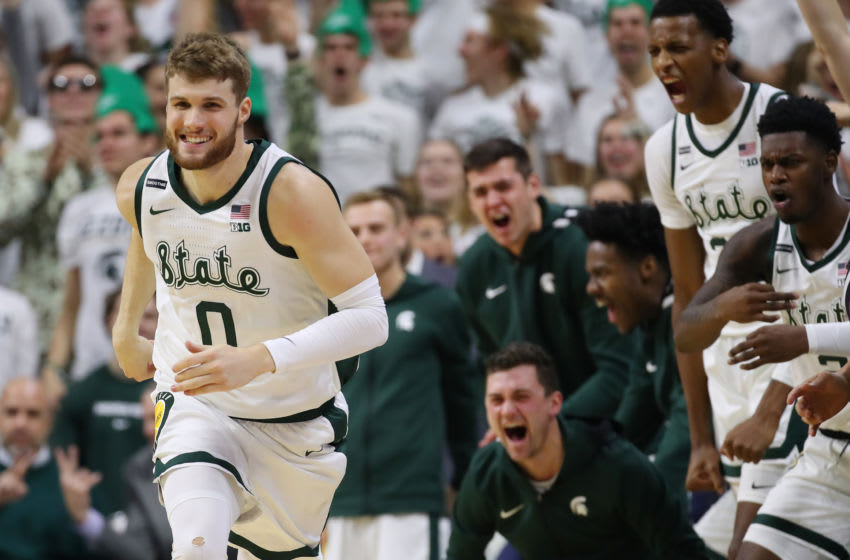 EAST LANSING, MICHIGAN - JANUARY 05: Kyle Ahrens #0 of the Michigan State Spartans reacts with teammates after a three point basket against the Michigan Wolverines during the second half at the Breslin Center on January 05, 2020 in East Lansing, Michigan. Michigan State won the game 87-69. (Photo by Gregory Shamus/Getty Images)