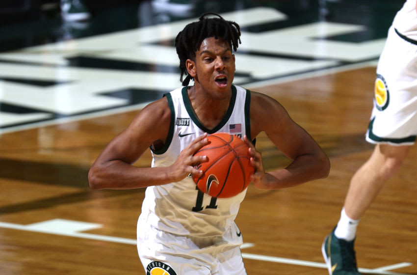 EAST LANSING, MICHIGAN - JANUARY 05: A.J. Hoggard #11 of the Michigan State Spartans looks to pass the ball in the first half against the Rutgers Scarlet Knights at Breslin Center on January 05, 2021 in East Lansing, Michigan. (Photo by Rey Del Rio/Getty Images)