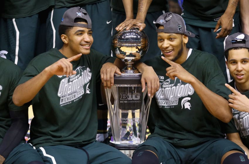 INDIANAPOLIS, IN - MARCH 16: Gary Harris #14 and Adreian Payne #5 of the Michigan State Spartans celebrates after the 69-55 win over the Michigan Wolverines during the finals of the Big Ten Basketball Tournament at Bankers Life Fieldhouse on March 16, 2014 in Indianapolis, Indiana. (Photo by Andy Lyons/Getty Images)