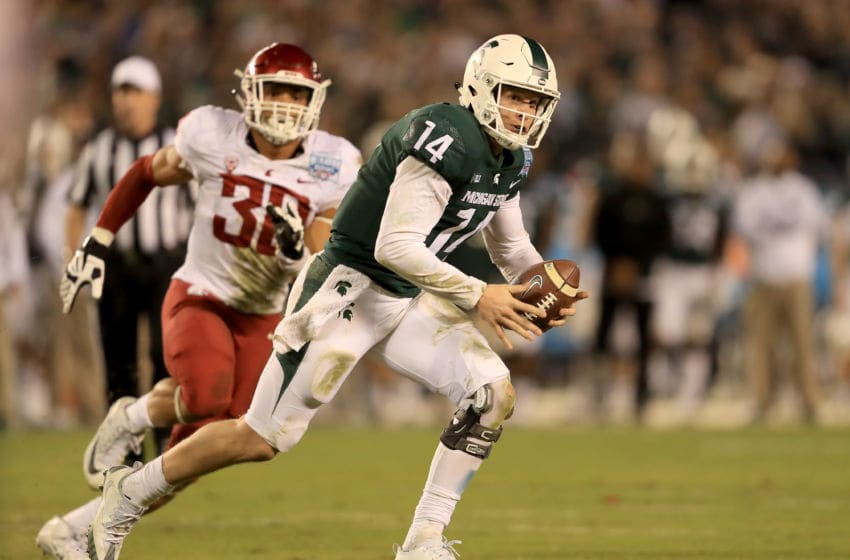 SAN DIEGO, CA - DECEMBER 28: Nnamdi Oguayo #30 of the Washington State Cougars pressures Brian Lewerke #14 of the Michigan State Spartans from the pocket during the second half of the SDCCU Holiday Bowl at SDCCU Stadium on December 28, 2017 in San Diego, California. (Photo by Sean M. Haffey/Getty Images)