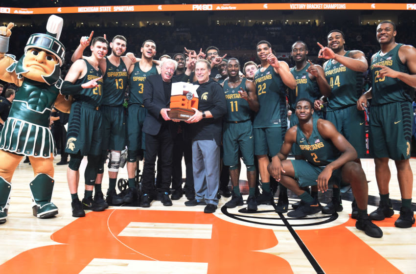 PORTLAND, OR - NOVEMBER 26: Nike co-founder Phil Knight presents head coach Tom Izzo of the Michigan State Spartans and the Michigan State Spartans the trophy for the 'Victory Bracket' Championship after the game during the PK80-Phil Knight Invitational presented by State Farm at the Moda Center on November 26, 2017 in Portland, Oregon. Michigan State won the game 63-45. (Photo by Steve Dykes/Getty Images)