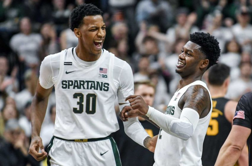 Michigan State's Marcus Bingham Jr., right, celebrates with Rocket Watts during a timeout in the second half on Tuesday, Feb. 25, 2020, at the Breslin Center in East Lansing. 200225 Msu Iowa 209a