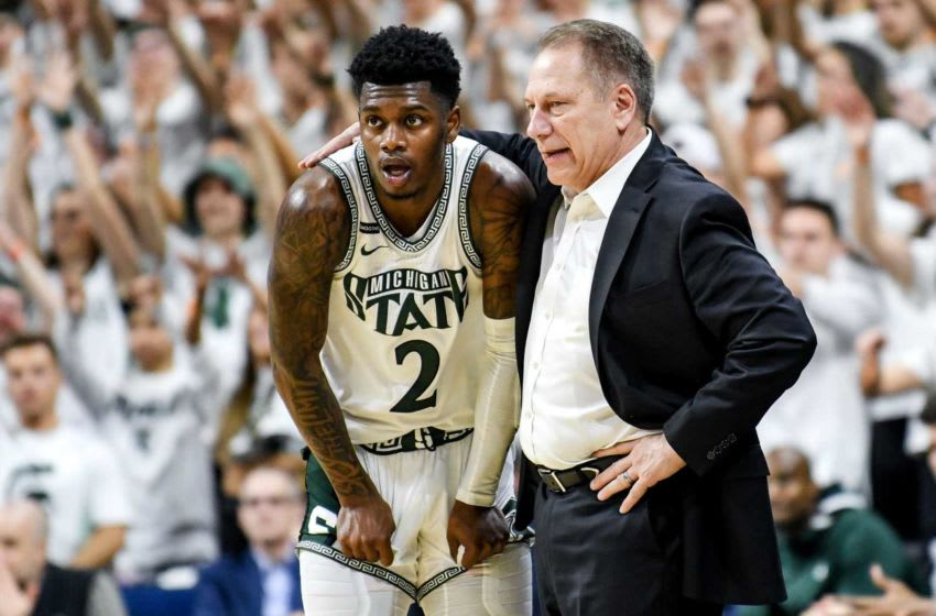 Michigan State's head coach Tom Izzo, right, talks with Rocket Watts during the first half on Sunday, March 8, 2020, at the Breslin Center in East Lansing. 200308 Msu Osu 082a