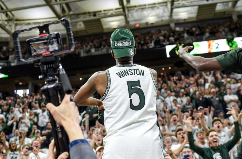 Michigan State's Cassius Winston celebrates after beating Ohio State on Sunday, March 8, 2020, at the Breslin Center in East Lansing. The Spartans won a share of the Big Ten Championship. 200308 Msu Osu 252a