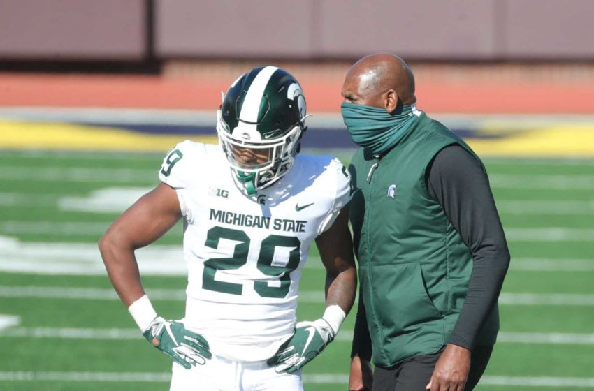 Michigan State Spartans coach Mel Tucker talks with cornerback Shakur Brown after a taunting penalty during the third quarter at Michigan Stadium in Ann Arbor, Saturday, Oct. 31, 2020. Michigan