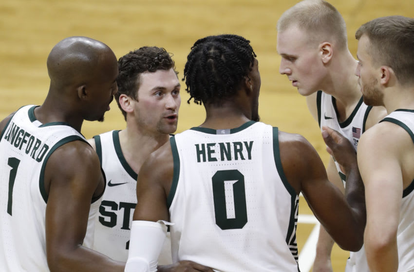 Nov 28, 2020; East Lansing, Michigan, USA; (Left to right) Michigan State Spartans guard Joshua Langford (1) guard Foster Loyer (3) forward Aaron Henry (0) forward Joey Hauser (20) and forward Thomas Kithier (15) talk in a huddle during the first half against the Notre Dame Fighting Irish at Jack Breslin Student Events Center. Mandatory Credit: Raj Mehta-USA TODAY Sports
