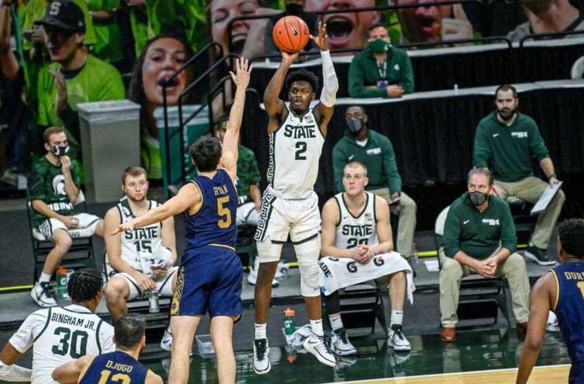 Michigan State's Rocket Watts, right, makes a 3-pointer over Notre Dame's Cormac Ryan during the second half on Saturday, Nov. 28, 2020, at the Breslin Center in East Lansing. 201128 Msu Notre Dame 062a
