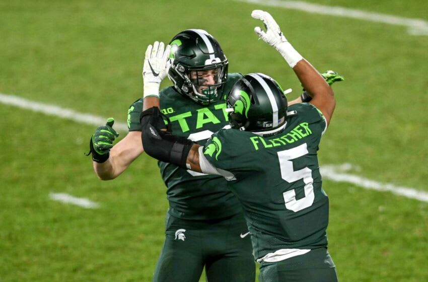 Michigan State's Jack Camper, left, celebrates recovering a Northwestern fumble with teammate Michael Fletcher during the fourth quarter on Saturday, Nov. 28, 2020, at Spartan Stadium in East Lansing. 201128 Msu Northwestern 143a