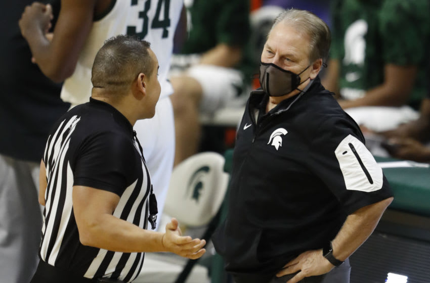 Dec 6, 2020; East Lansing, Michigan, USA; Michigan State Spartans head coach Tom Izzo talks with a referee during the second half against the Western Michigan Broncos at Jack Breslin Student Events Center. Mandatory Credit: Raj Mehta-USA TODAY Sports