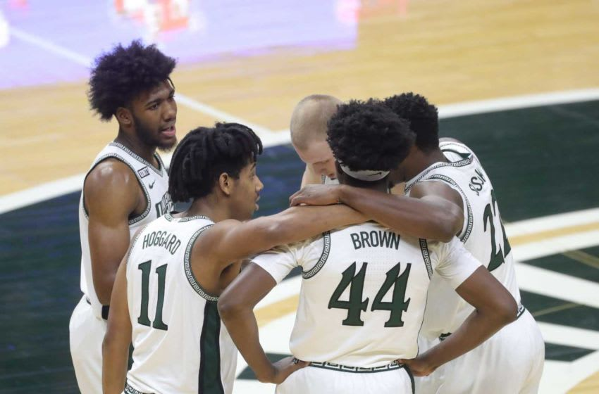 Michigan State Spartans basketball players huddle on the court Saturday, Feb. 13, 2021, during a game vs. the Iowa Hawkeyes at Breslin Center. Iowa won, 88-58. Msu Iowa huddle team spartans michigan state