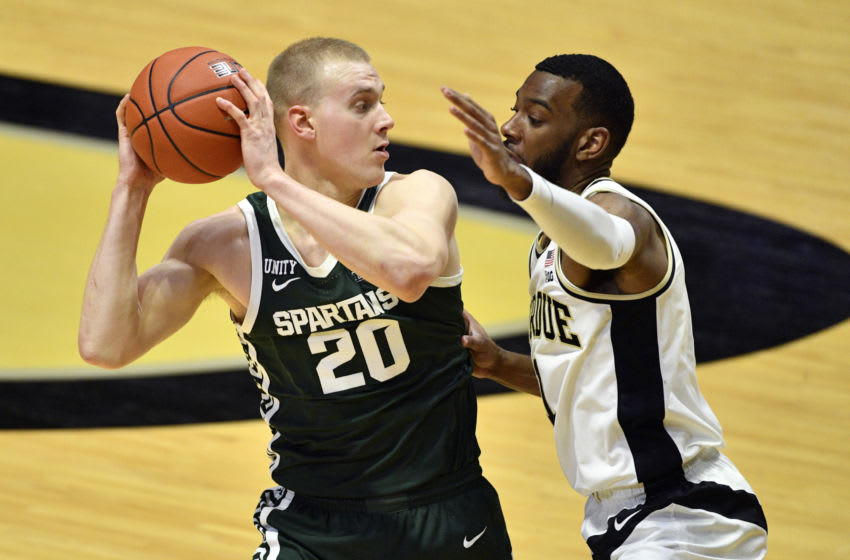 Feb 16, 2021; West Lafayette, Indiana, USA; Michigan State Spartans forward Joey Hauser (20) looks for an opening around Purdue Boilermakers forward Aaron Wheeler (1) during the second half of the game at Mackey Arena. Mandatory Credit: Marc Lebryk-USA TODAY Sports