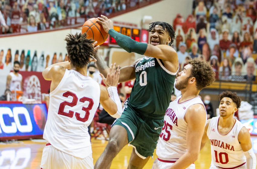 Feb 20, 2021; Bloomington, Indiana, USA; Michigan State Spartans forward Aaron Henry (0) drives against Indiana Hoosiers forward Trayce Jackson-Davis (23) and forward Race Thompson (25) in the second half at Simon Skjodt Assembly Hall. Mandatory Credit: Trevor Ruszkowski-USA TODAY Sports
