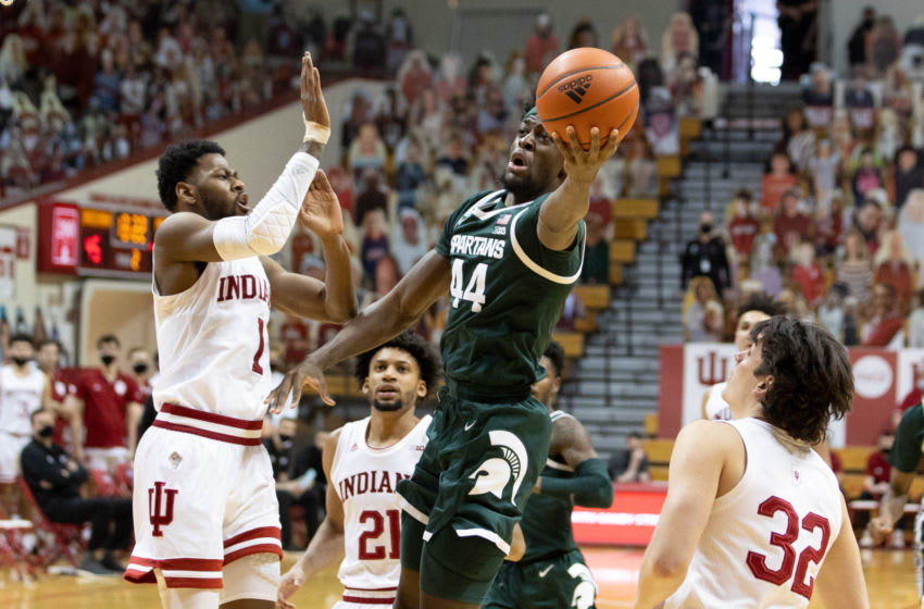 Feb 20, 2021; Bloomington, Indiana, USA; Michigan State Spartans forward Gabe Brown (44) shoots the ball while Indiana Hoosiers guard Al Durham (1) defends in the second half at Simon Skjodt Assembly Hall. Mandatory Credit: Trevor Ruszkowski-USA TODAY Sports