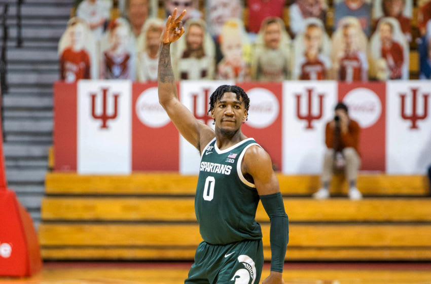 Feb 20, 2021; Bloomington, Indiana, USA; Michigan State Spartans forward Aaron Henry (0) celebrates after a basket against the Indiana Hoosiers in the second half at Simon Skjodt Assembly Hall. Mandatory Credit: Trevor Ruszkowski-USA TODAY Sports