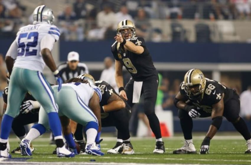Sep 28, 2014; Arlington, TX, USA; New Orleans Saints quarterback Drew Brees (9) on the line of scrimmage during the game against the Dallas Cowboys at AT&T Stadium. Dallas beat New Orleans 38-17. Mandatory Credit: Tim Heitman-USA TODAY Sports
