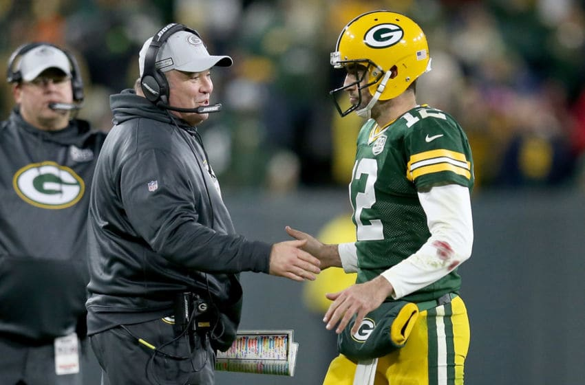 GREEN BAY, WI - OCTOBER 15: Head coach Mike McCarthy and Aaron Rodgers #12 of the Green Bay Packers celebrate after scoring a touchdown in the fourth quarter against the San Francisco 49ers at Lambeau Field on October 15, 2018 in Green Bay, Wisconsin. (Photo by Dylan Buell/Getty Images)