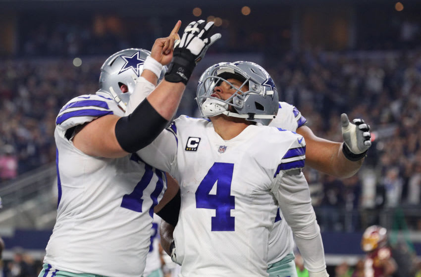 ARLINGTON, TEXAS - NOVEMBER 22: Zack Martin #70 celebrates the fourth quarter touchdown by Dak Prescott #4 of the Dallas Cowboys against the Washington Redskins at AT&T Stadium on November 22, 2018 in Arlington, Texas. (Photo by Richard Rodriguez/Getty Images)