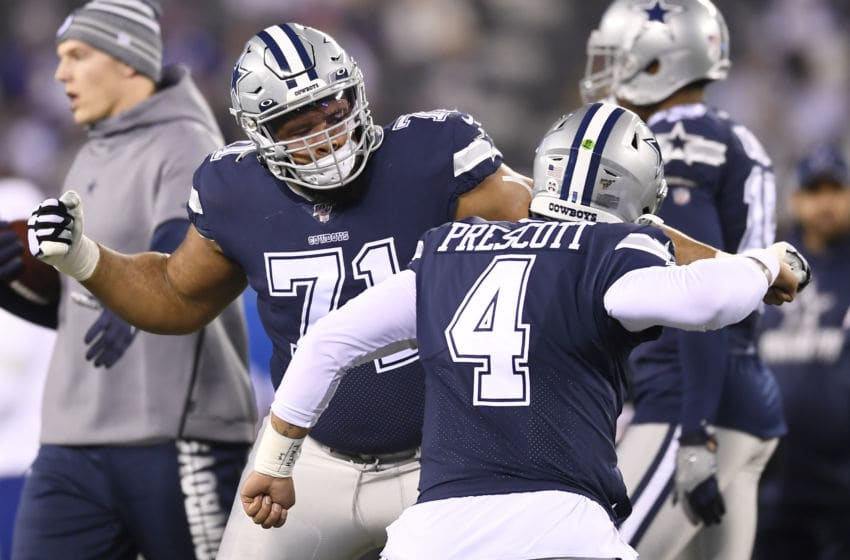 EAST RUTHERFORD, NEW JERSEY - NOVEMBER 04: Dak Prescott #4 of the Dallas Cowboys high-fives La'el Collins #71 during warmups against the New York Giants at MetLife Stadium on November 04, 2019 in East Rutherford, New Jersey. (Photo by Sarah Stier/Getty Images)