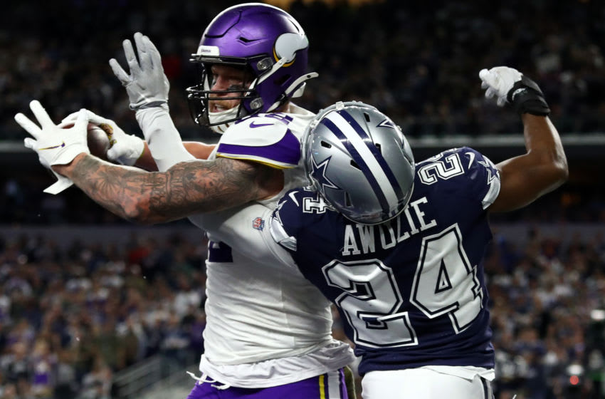 ARLINGTON, TEXAS - NOVEMBER 10: Kyle Rudolph #82 of the Minnesota Vikings makes a two-point conversion against Chidobe Awuzie #24 of the Dallas Cowboys in the third quarter at AT&T Stadium on November 10, 2019 in Arlington, Texas. (Photo by Ronald Martinez/Getty Images)