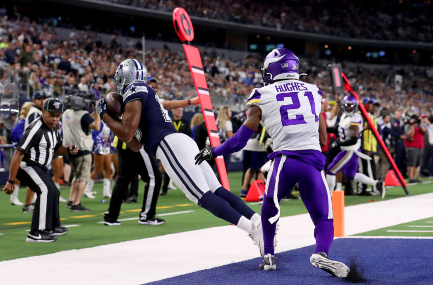 ARLINGTON, TEXAS - NOVEMBER 10: Amari Cooper #19 of the Dallas Cowboys pulls in a pass for a touchdown against Mike Hughes #21 of the Minnesota Vikings in the second half at AT&T Stadium on November 10, 2019 in Arlington, Texas. (Photo by Tom Pennington/Getty Images)