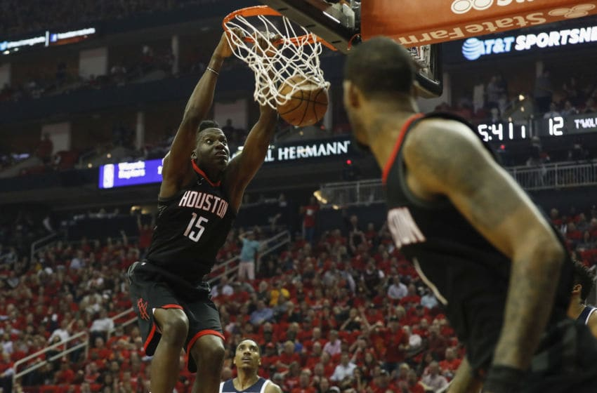 HOUSTON, TX - APRIL 25: Clint Capela #15 of the Houston Rockets dunks the ball in the first half defended by Jeff Teague #0 of the Minnesota Timberwolves during Game Five of the first round of the 2018 NBA Playoffs at Toyota Center on April 25, 2018 in Houston, Texas. NOTE TO USER: User expressly acknowledges and agrees that, by downloading and or using this photograph, User is consenting to the terms and conditions of the Getty Images License Agreement. (Photo by Tim Warner/Getty Images)