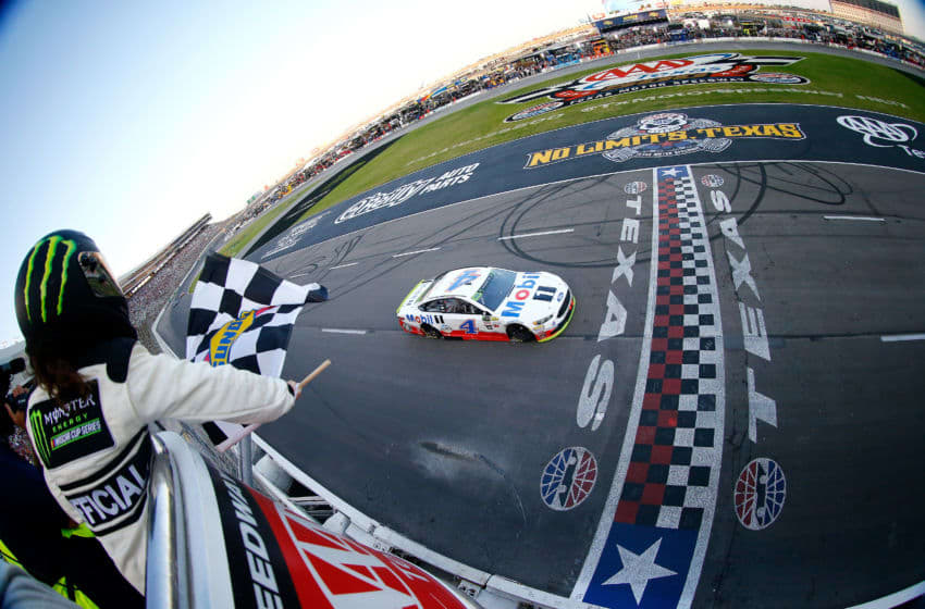 FORT WORTH, TX - NOVEMBER 05: Kevin Harvick, driver of the #4 Mobil 1 Ford, takes the checkered flag to win the Monster Energy NASCAR Cup Series AAA Texas 500 at Texas Motor Speedway on November 5, 2017 in Fort Worth, Texas. (Photo by Jonathan Ferrey/Getty Images)