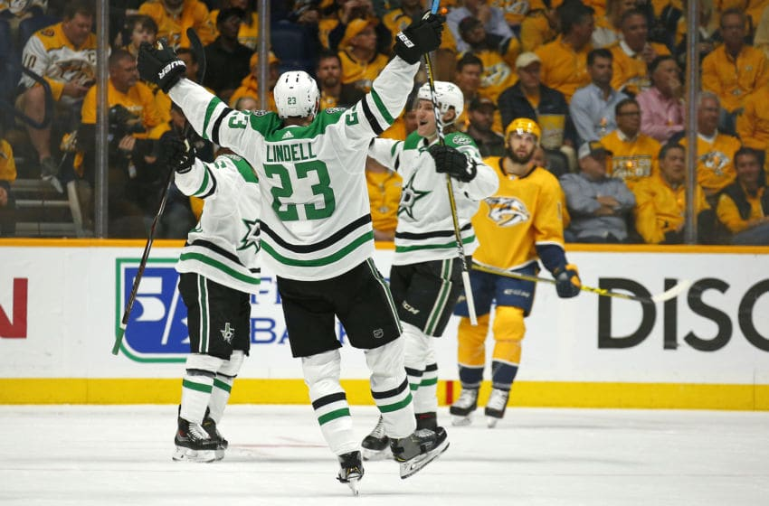 NASHVILLE, TENNESSEE - APRIL 10: Esa Lindell #23 of the Dallas Stars reacts after a goal by teammate Mats Zuccarello #36 against the Nashville Predators during the third period of a 3-2 Stars victory in Game One of the Western Conference First Round during the 2019 NHL Stanley Cup Playoffs at Bridgestone Arena on April 10, 2019 in Nashville, Tennessee. (Photo by Frederick Breedon/Getty Images)