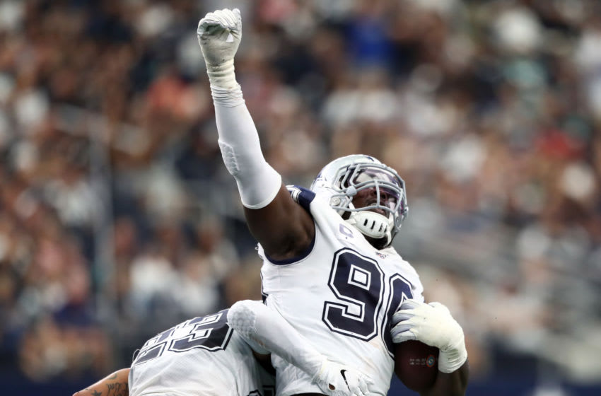 ARLINGTON, TEXAS - SEPTEMBER 22: Demarcus Lawrence #90 of the Dallas Cowboys reacts after a fumble recovery against the Miami Dolphins in the second quarter at AT&T Stadium on September 22, 2019 in Arlington, Texas. (Photo by Ronald Martinez/Getty Images)