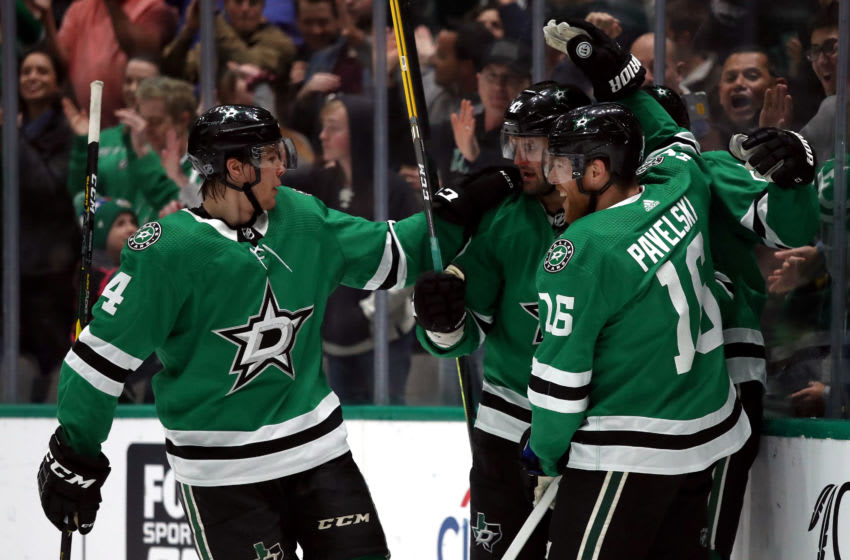 DALLAS, TEXAS - FEBRUARY 23: Joe Pavelski #16 of the Dallas Stars celebrates a goal with Alexander Radulov #47 and Miro Heiskanen #4 of the Dallas Stars against the Chicago Blackhawks in the first period at American Airlines Center on February 23, 2020 in Dallas, Texas. (Photo by Ronald Martinez/Getty Images)