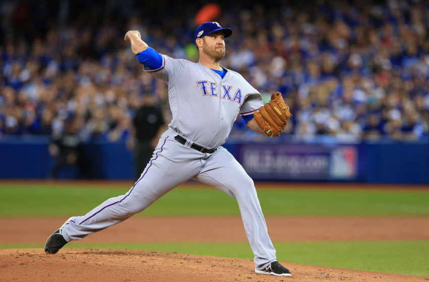 Texas rangers Colby Lewis (Photo by Vaughn Ridley/Getty Images)