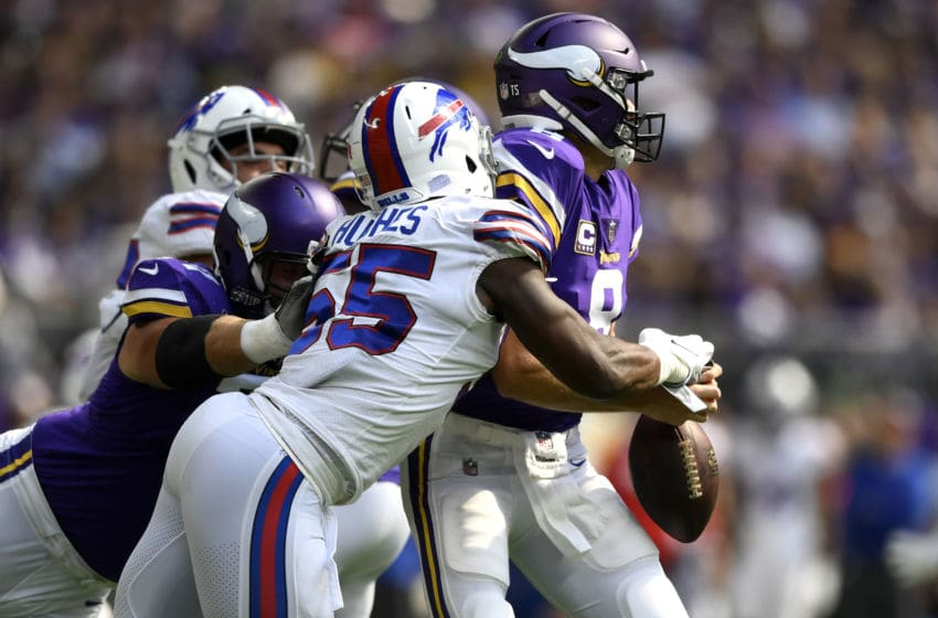 MINNEAPOLIS, MN - SEPTEMBER 23: Jerry Hughes #55 of the Buffalo Bills strips the ball out of the hands of Kirk Cousins #8 of the Minnesota Vikings in the first quarter of the game at U.S. Bank Stadium on September 23, 2018 in Minneapolis, Minnesota. (Photo by Hannah Foslien/Getty Images)