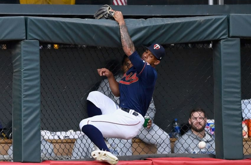 MINNEAPOLIS, MN - MAY 28: Byron Buxton #25 of the Minnesota Twins crashes into the center field wall after he was unable to catch a triple hit by Yasmani Grandal #10 of the Milwaukee Brewers during the second inning of the interleague game on May 28, 2019 at Target Field in Minneapolis, Minnesota. a(Photo by Hannah Foslien/Getty Images)