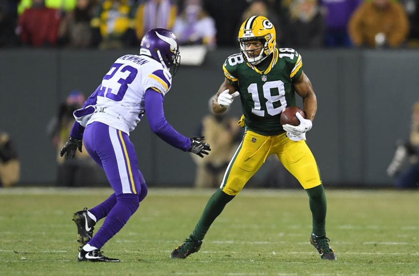 GREEN BAY, WI - DECEMBER 23: Randall Cobb #18 of the Green Bay Packers is pursued by Terence Newman #23 of the Minnesota Vikings during the first half at Lambeau Field on December 23, 2017 in Green Bay, Wisconsin. (Photo by Stacy Revere/Getty Images)